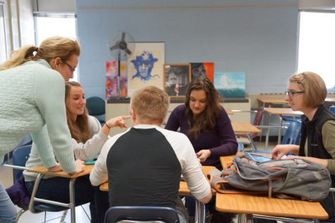 Mrs. Thomas works with students in small groups.