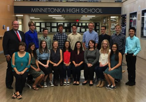 Jeff Erickson poses with National Merit Scholars.