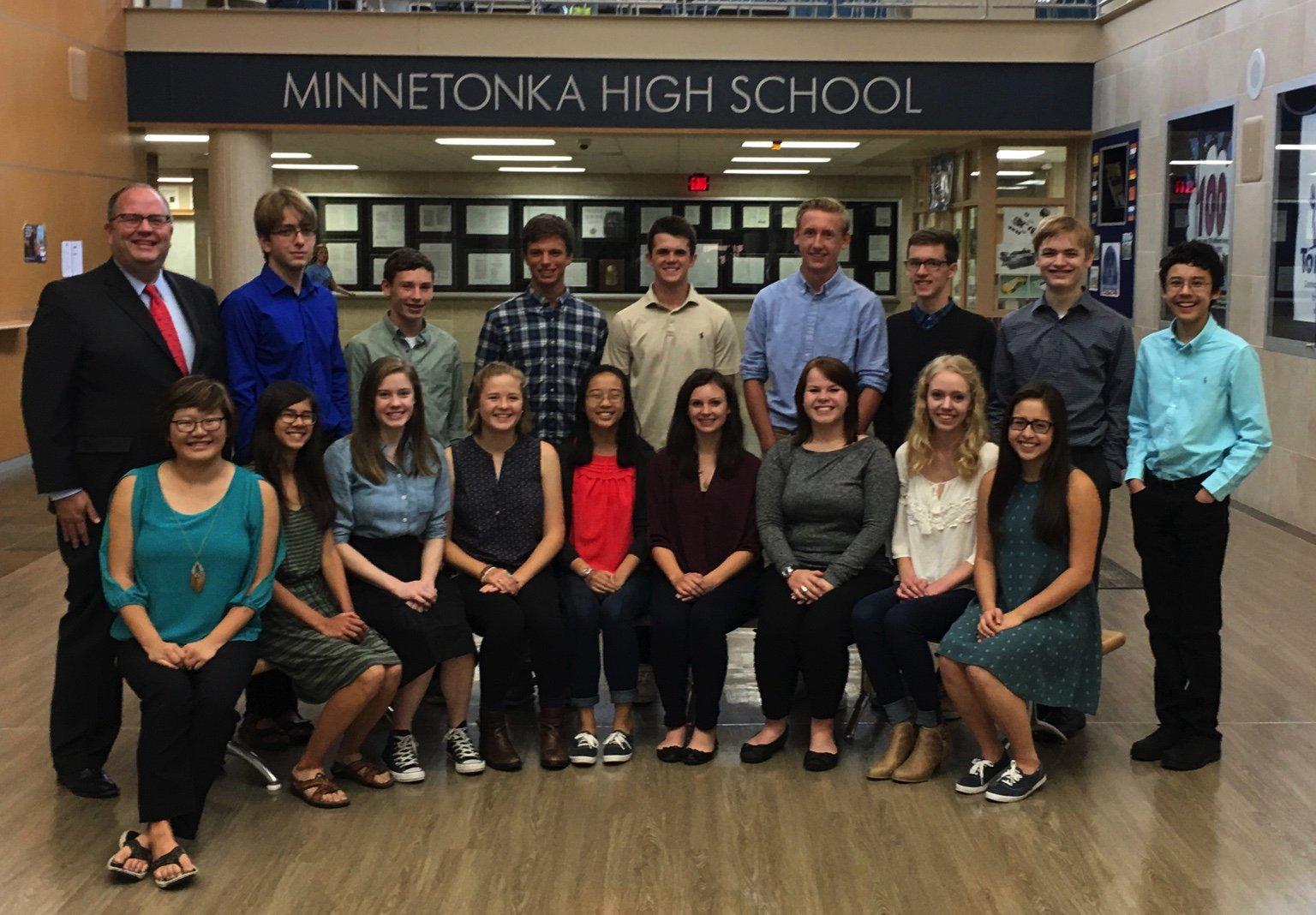 Jeff Erickson poses with National Merit Scholars.