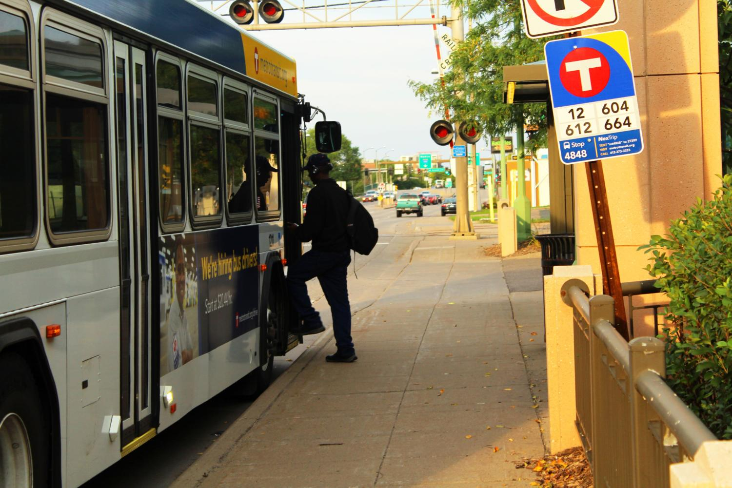 This commuter boards a public bus in Minneapolis.